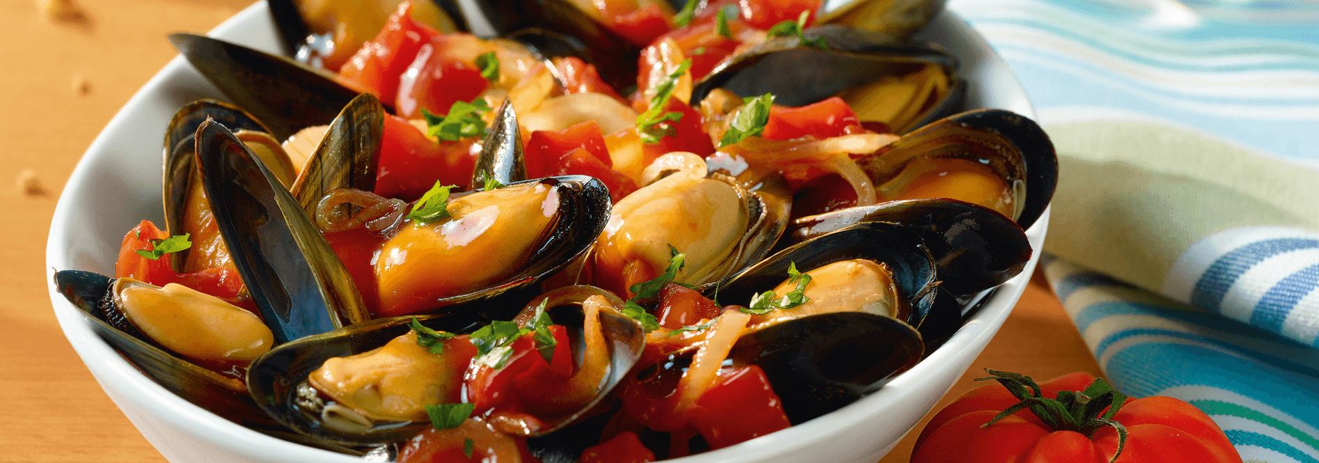 Rezeptfoto Miesmuscheln in Tomaten Weißwein Sauce von COSTA Meeresspezialitäten